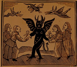 Witches receiving images from a Devil, for use in their charms. From John Aston Chapbooks of the 18th Century, London. 1882